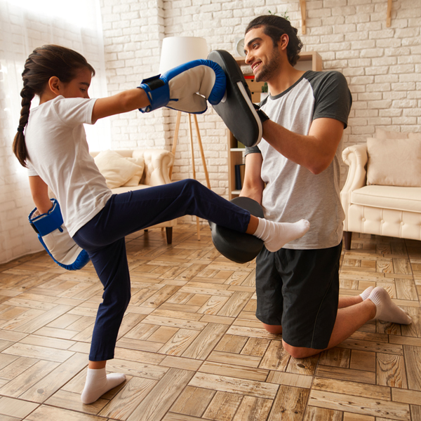 father and daughter sparing together